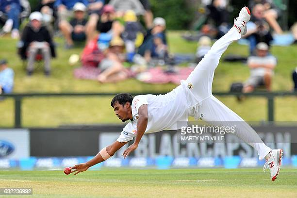 TOPSHOT New Zealand's Rubel Hossain attempts to catch New Zealand's Ross Taylor during day Two of the second international Test cricket match between...