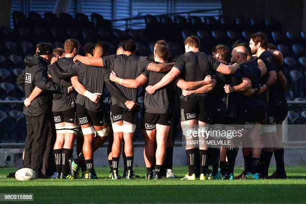 TOPSHOT New Zealand's rugby players huddle during the captain's run at Forsyth Barr Stadium in Dunedin on June 22 a day ahead of the All Blacks'...