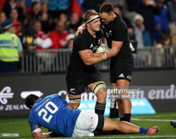 New Zealand's Sam Cane celebrates his try with teammate Israel Dagg as Samoa's Alafoti Faosiliva lies on the field during the international rugby...
