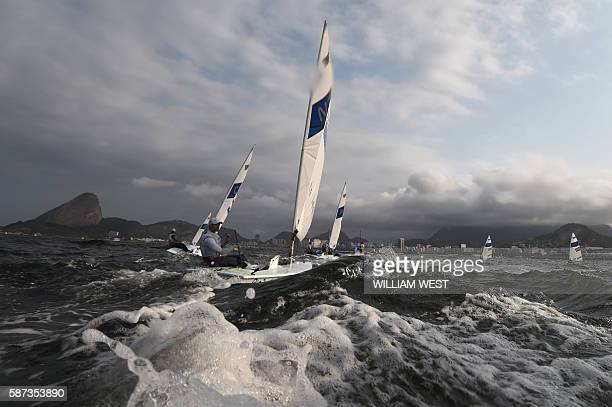 New Zealand's Sam Meech sails after the Laser Men sailing race on Marina da Gloria in Rio de Janerio during the Rio 2016 Olympic Games on August 8,...