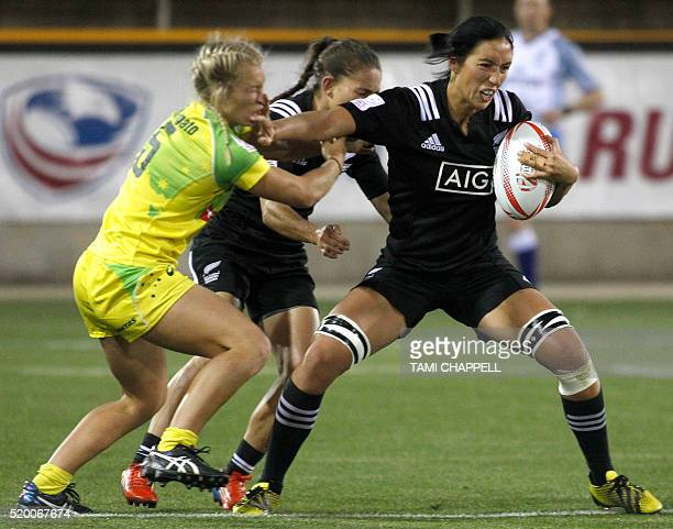 New Zealand's Sarah Goss defends against Australia's Emma Tonegato at the final of the Women's 2016 USA Sevens Rugby Tournament in Kennesaw Georgia...