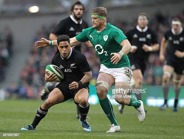 New Zealand's scrum half Aaron Smith is tackled by Ireland's No 8 Jamie Heaslip during the international rugby union test match between Ireland and...