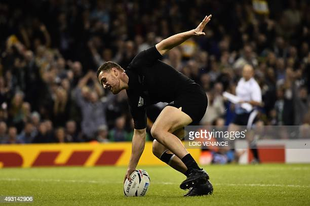 New Zealand's scrum half Tawera KerrBarlow scores a try during a quarter final match of the 2015 Rugby World Cup between New Zealand and France at...