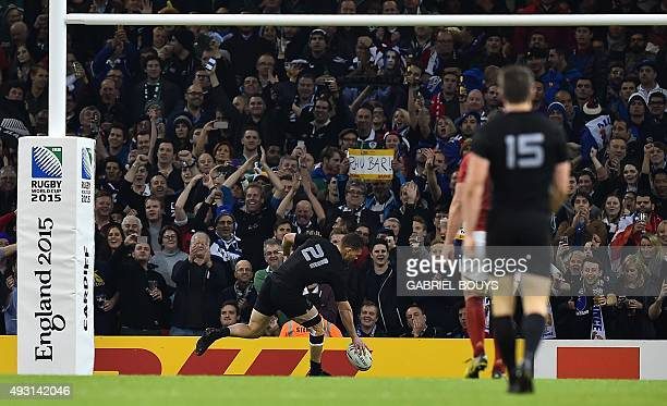 New Zealand's scrum half Tawera KerrBarlow scores his team's ninth try during a quarter final match of the 2015 Rugby World Cup between New Zealand...