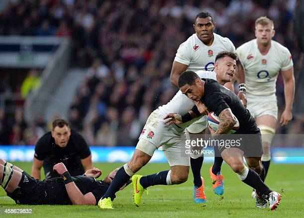 New Zealand's scrumhalf Aaron Smith vies with England's scrumhalf Danny Care during the Autumn international rugby union Test match between England...
