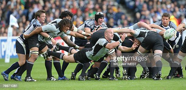 New Zealand's scrum-half Brendon Leonard passes the ball from the back of the scrum during the rugby union World cup match Scotland vs. New Zealand,...