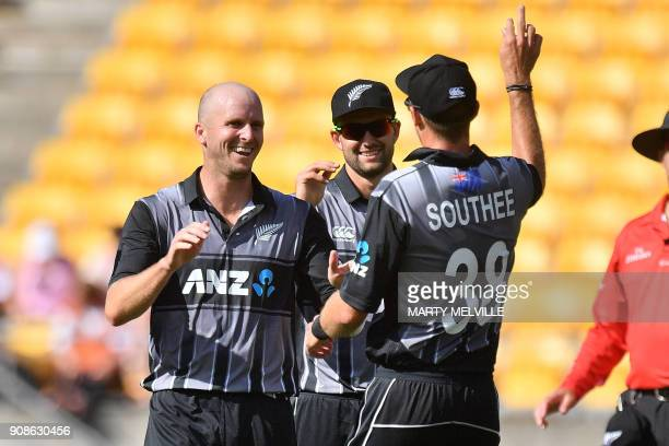 New Zealand's Seth Rance celebrates with teammate Tim Southee after Pakistan's Hasan Ali was caught during the first Twenty20 international cricket...