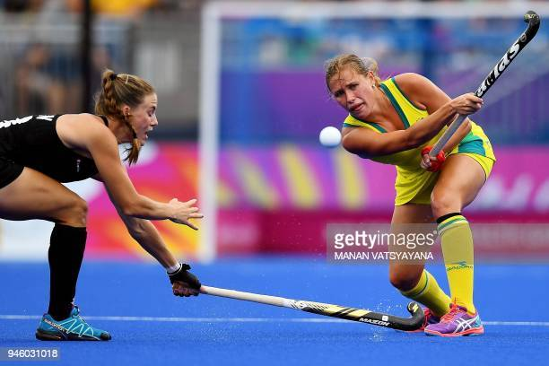New Zealand's Shiloh Gloyn challenges Kaitlin Nobbs of Australia during their women's field hockey gold medal match at the 2018 Gold Coast...