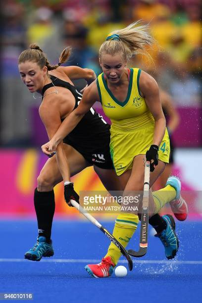 New Zealand's Shiloh Gloyn vies for the ball with Stephanie Kershaw of Australia during their women's field hockey gold medal match of the 2018 Gold...