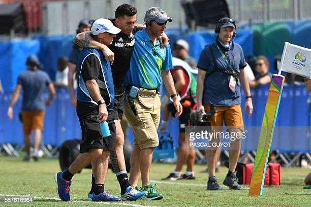 TOPSHOT New Zealand's Sonny Bill Williams is helped from the field in the mens rugby sevens match between New Zealand and Japan during the Rio 2016...