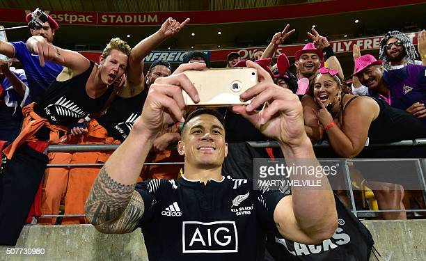 New Zealand's Sonny Bill Williams takes a selfie with fans during the cup final against South Africa on the second day of the Wellington Sevens rugby...