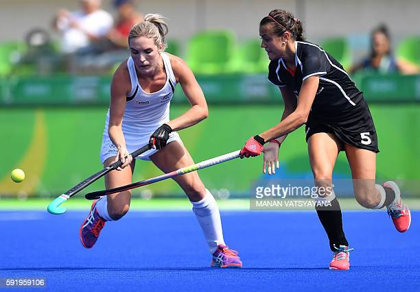 New Zealand's Sophie Cocks vies with Germany's Selin Oruz during the women's Bronze medal hockey Germany vs New Zealand match of the Rio 2016...