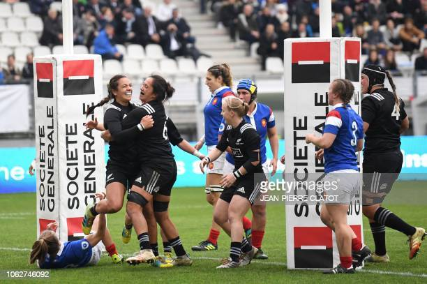 New Zealand's Stacey Waaka celebrates with team mates after scoring a try during the women rugby union match between France and New Zealand on...