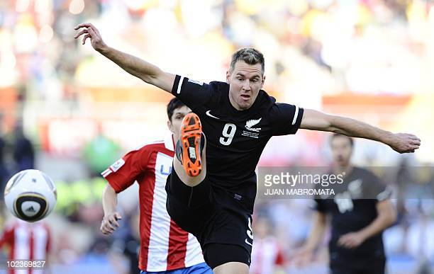 New Zealand's striker Shane Smeltz kicks the ball in front of Paraguay's defender Denis Caniza during the Group F first round 2010 World Cup football...