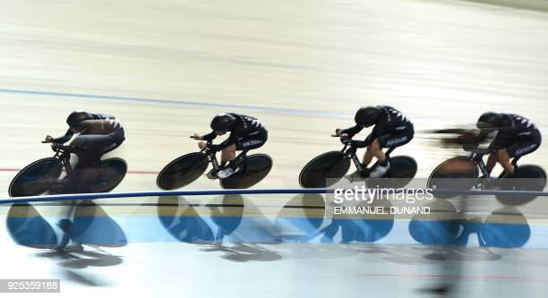New Zealand's team competes in the Women's Team Pursuit qualifying round during the UCI Track Cycling World Championships in Apeldoorn on Februray 28...