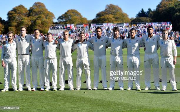 New Zealand's team stands for their national anthem before the second cricket Test match between New Zealand and England at Hagley Oval in...