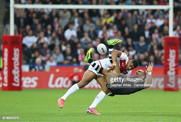 New Zealand's Thomas Leuluai is tackled by England's Kallum Watkins during the Four Nations match between the England and New Zealand Kiwis at...