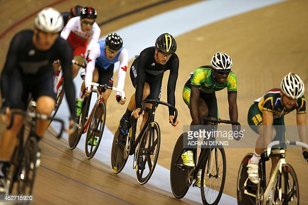 New Zealand's Thomas Scully competes with other riders in the men's 40km points race qualifying round heat 1 in the Sir Chris Hoy Velodrome during...