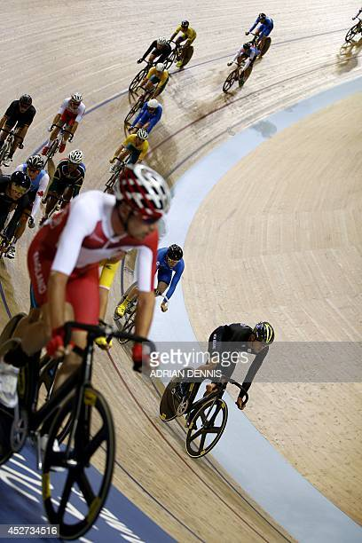 New Zealand's Thomas Scully winner of the gold medal compete in the men's 40km points race final in the Sir Chris Hoy Velodrome during the 2014...