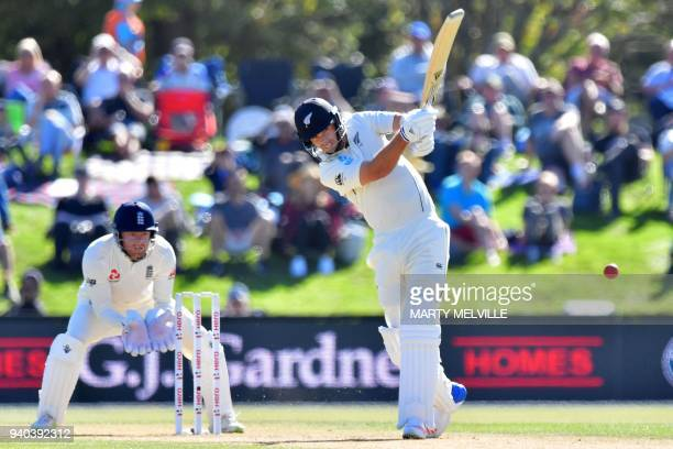 New Zealand's Tim Southee bats watched by England's Jonny Bairstow during day three of the second cricket Test match between New Zealand and England...