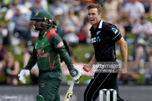 New Zealand's Tim Southee celebrates taking the wicket of Bangladesh's Liton Das during the third oneday international cricket match between New...