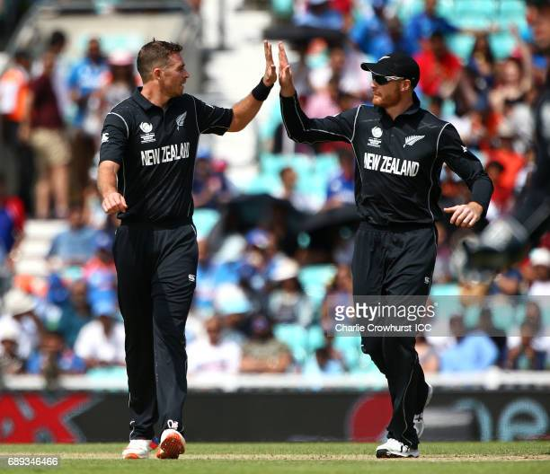 New Zealand's Tim Southee celebrates with Martin Guptill after taking the wicket of Ajinkya Rahane of India during the ICC Champions Trophy Warmup...