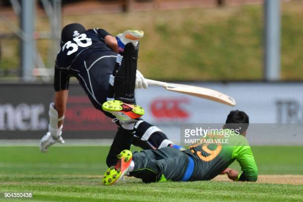 New Zealand's Tim Southee trips over Pakistan's Shadab Khan during the third one day international cricket match between New Zealand and Pakistan at...