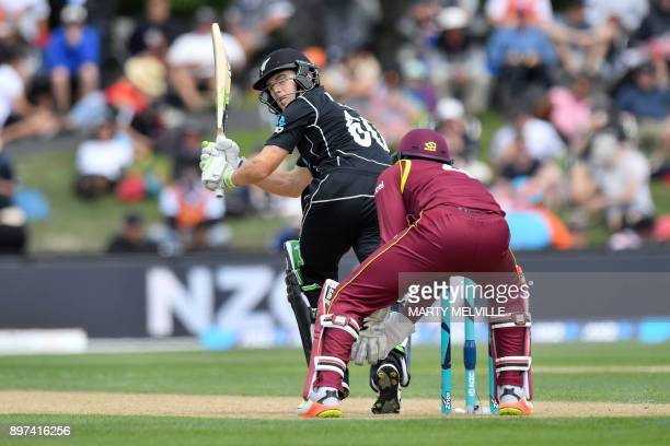 New Zealand's Todd Astle bats as West Indies wicketkeeper Shai Hope looks on during the second oneday international cricket match between New Zealand...