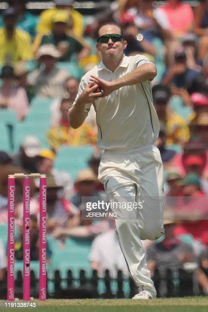 New Zealand's Todd Astle bowls during the first day of the third cricket Test match between Australia and New Zealand at the Sydney Cricket Ground in...