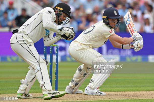 New Zealand's Tom Blundell catches the ball to take the wicket of England's Ollie Pope for 19 runs on the first day of the second Test cricket match...