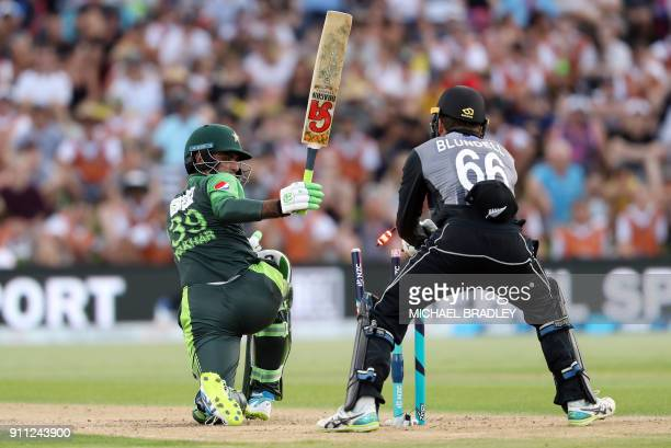 New Zealand's Tom Blundell is unable to stump Pakistan's Fakhar Zaman during the third Twenty20 international cricket match between New Zealand and...