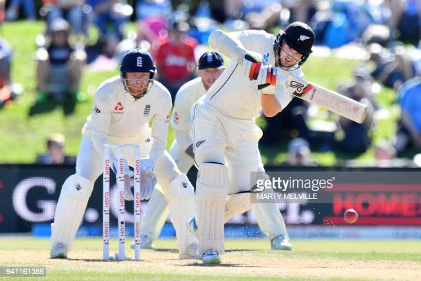 New Zealand's Tom Latham bats watched by England's keeper Jonny Bairstow during day five of the second cricket Test match between New Zealand and...