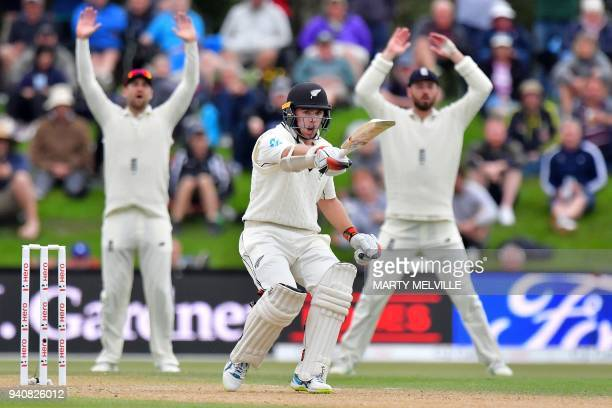 New Zealand's Tom Latham calls to team mate Jeet Raval watched by England's James Vince and Dawid Malan R during day four of the second cricket Test...