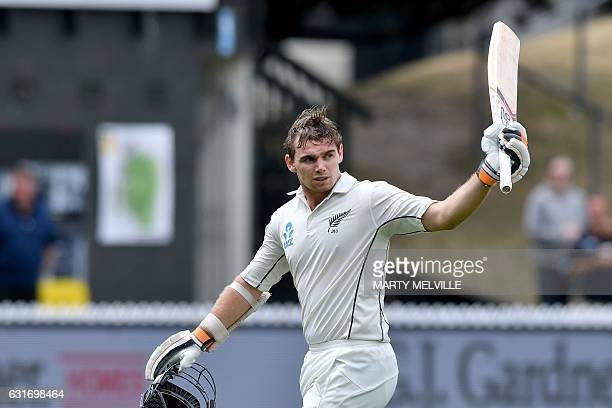 New Zealand's Tom Latham walks from the field after being caught with LBW during day four of the first international Test cricket match between New...