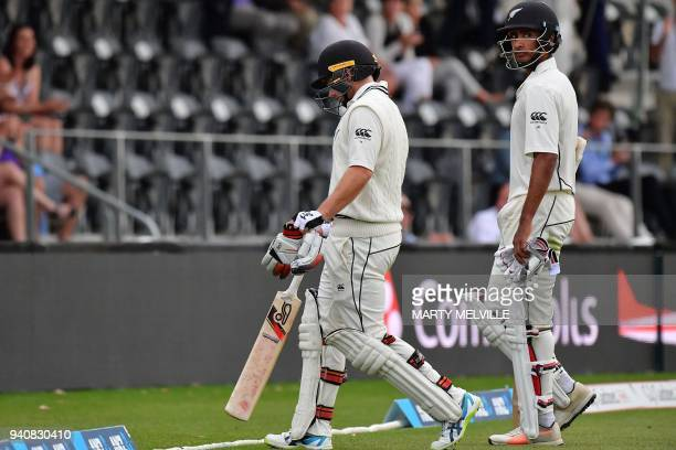 New Zealand's Tom Latham walks off the field with teammate Jeet Raval after play was stopped for bad light during day four of the second cricket Test...