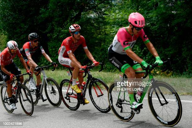 New Zealand's Tom Scully Belgium's Dimitri Claeys Switzerland's Michael Schar and Belgium's Thomas De Gendt ride during their fourmen breakaway in...