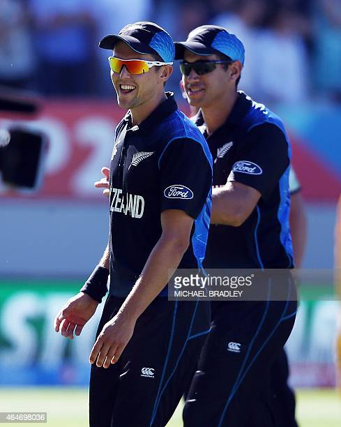New Zealand's Trent Boult and Ross Taylor leave the field during the Pool A 2015 Cricket World Cup match between New Zealand and Australia at Eden...