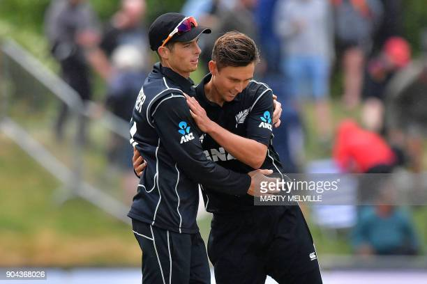 New Zealand's Trent Boult celebrates bowling Pakistan's Rumman Raees ending the Pakistan innings with team mate Mitchell Santner during the third one...