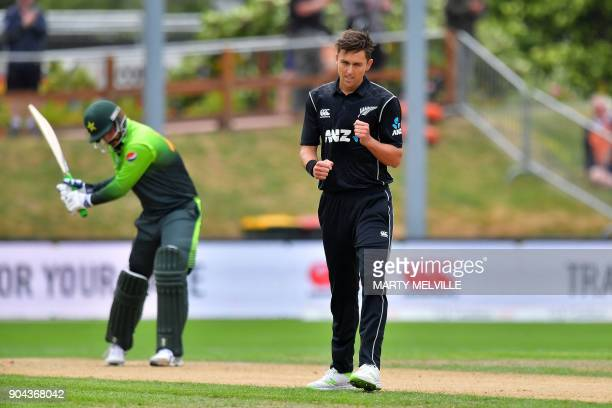New Zealand's Trent Boult celebrates bowling Pakistan's Rumman Raees ending the Pakistan innings during the third one day international cricket match...