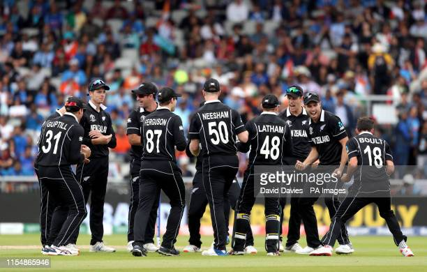 New Zealand's Trent Boult celebrates with team-mates after taking the wicket of India's Virat Kohli during the ICC World Cup, Semi Final at Old...
