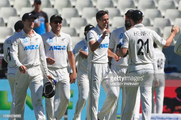 New Zealand's Trent Boult celebrates with teammates after taking the final wicket, that of England's Olly Stone with the first ball of the morning on...