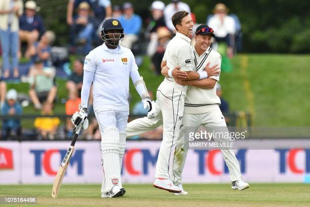 New Zealand's Trent Boult with teammate Neil Wagner celebrates Sri Lanka's Lahiru Kumara being caught with LBW ending the Sri Lankan innings watched...
