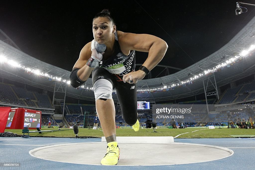 TOPSHOT - New Zealand's Valerie Adams competes in the Women's Shot Put Final during the athletics event at the Rio 2016 Olympic Games at the Olympic Stadium in Rio de Janeiro on August 12, 2016. / AFP / Adrian DENNIS