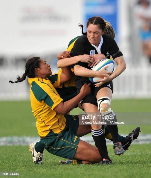 New Zealand's Victoria Grant is tackled by Australia's Se'el Sa'U and Tobie McGann during the IRB Women's World Cup match at Surrey Sports Park...