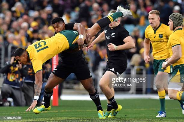 TOPSHOT New Zealand's Waisake Naholo tackles Australia's Israel Folau during the Rugby Championship Bledisloe Cup Test match in Sydney on August 18...