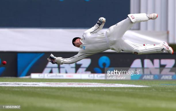 TOPSHOT New Zealand's wicketkeeper BJ Watling dives but fails to take a catch from England's Rory Burns during the third day of the second cricket...