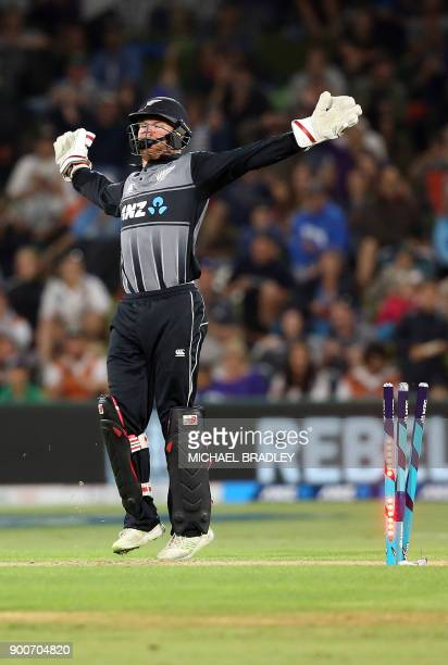 New Zealand's wicketkeeper Glenn Phillips celebrates the runout of West Inides batsman Shimron Hetmyer during the third Twenty20 international...