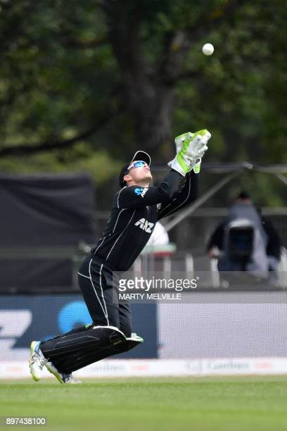 New Zealand's wicketkeeper Tom Latham takes the catch of West Indies batsman Shai Hope during the second oneday international cricket match between...