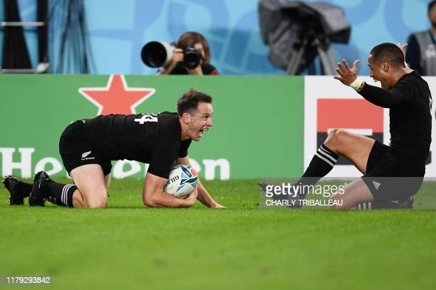 TOPSHOT New Zealand's wing Ben Smith reacts with New Zealand's scrumhalf Aaron Smith after scoring a try during the Japan 2019 Rugby World Cup bronze...