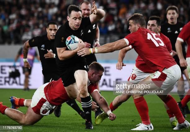 TOPSHOT New Zealand's wing Ben Smith runs to score a try during the Japan 2019 Rugby World Cup bronze final match between New Zealand and Wales at...